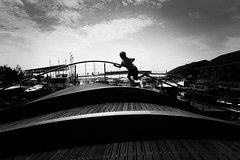 Run (Daren N.) Tags: toronto harbourfront boardwalk curves boy run contrast