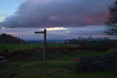 Sheriffmuir (GeoTechRyan) Tags: sky grass green bench red sony sonyslta58 sign post signpost redsky