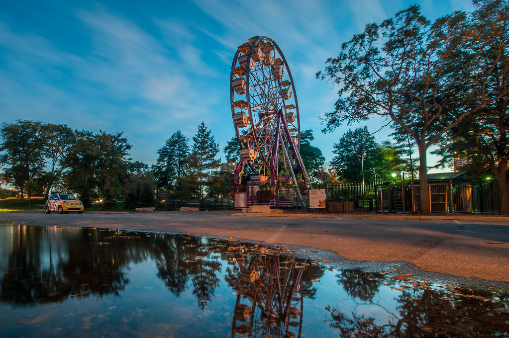 The Lincoln Park Zoo Ferris Wheel reflected onto a rain puddle.