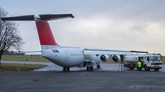10 gallons of 4 star.. (Al Henderson) Tags: egtc avro airliner rj100 aviation cranfield bedfordshire e3380 hbiyt swissinternational bedford england unitedkingdom gb