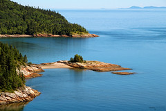 Saint Lawrence River - Tadoussac (Québec, Canada) (Andrea Moscato) Tags: andreamoscato canada america view vista vivid landscape paesaggio overlook blue green river fiume acqua water freshwater rock stones pine trees scogliera fiordo day light shadow reflection riflesso nature natura natural naturale np nationalpark park parco island isola montagna mountain