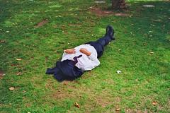 Death by snake bite. (deepstoat) Tags: london film grass zeiss 35mm snake asleep kodakportra160vc contaxt3 lunchbreak yetanotherphotoofsomeoneasleepbutatleastthetieisinterestingandsuggestive aconstrictorobviously