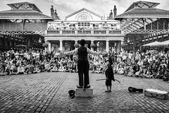 An audience at the garden (shotbywiles) Tags: street london comedy fuji audience market streetphotography tourists actor coventgarden fujifilm entertainer cobbles westend assistant charliechaplin wiles streetphotographer coventgardenmarket fujix silentcomedy xpro1 xf18mm wilesphotographer wilesphotography wilesstreetphotographer
