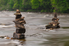 A delicate balancing act (tquist24) Tags: longexposure river geotagged nikon rocks paradise unitedstates michigan rapids upperpeninsula tahquamenonfalls rockpiles tahquamenonriver tahquamenonfallsstatepark nikond5300