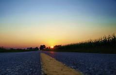 STRANGE ROAD SUNSET (nelhiebelv) Tags: corn yellowline strangehighway