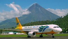 Mayon Volcano (Mount Mayon) and Cebu Pacific Air Airbus A320, view from Legazpi airport, province of Albay, Philippines (Darius Travel Photography) Tags: pentax philippines airbus mayon filipinas pilipinas legaspi legazpi albay    cebupacificair pentaxk100dsuper  filipinai   a320mayonvolcanomayon volcanobulkang mayonbulkan mayonmount