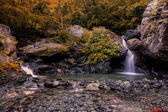 Autumn... (FotoNazario2) Tags: autumn waterfall greenery trees plants stones rocks forest environment colors water leaves longexposure silky landscape