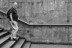 Manchester 038 (Peter.Bartlett) Tags: manchester bag noiretblanc olympusomdem5 unitedkingdom people city urbanarte wall walking lunaphoto man urban steps monochrome uk m43 microfourthirds streetphotography bw peterbartlett macphuntonality blackandwhite eyecontact candid england gb rail