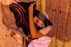 Sun. Wind. Smile (.sl.) Tags: mhamid maroc people portrait streetphotography girl hijab door desert scarf