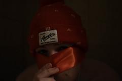akomplice . (Taran W) Tags: red hat ribbon mask people portrait portraiture face eyes light shadows hand fingers akomplice