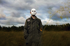 Time is Relative (jksonnen) Tags: selfportrait whitemask mask mysterious portrait armyjacket