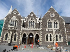 Christchurch. Earthquake damage almost repaired and building from 1880s ready for re opening.Once part of the University of Canterberry. (denisbin) Tags: christchurch artscentre tram workmen tradies paving men gothic canterberryuniversity