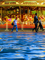 For Your Entertainment (stephenbryan825) Tags: albertdock liverpool blue merrygoround orange people puddle quirky rain reflection selects vivid wetpavement yellow