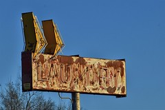 Laundry (slammerking) Tags: neon sign vintage old rusty up neglected peelingpaint metal