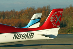 CIRRUS SR22 N53LG, N89NB (BIKEPILOT) Tags: blackbushe eglk airport airfield aerodrome aircraft aeroplane aviation flying hampshire uk greatbritain cirrus sr22t n53lg cirrussr22 n89nb red white