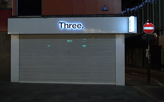 Three (Tony Worrall) Tags: preston north northwest lancs lancashire england northern uk update place location visit area county attraction open stream tour country welovethenorth unitedkingdom night dark urban street outside three closed sign shop sell buy barrier shutter bland small