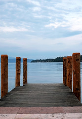 .pier in Sal (]babi]) Tags: travel lake holiday love water relax pier solitude loneliness peace atmosphere calm melancholy gardalake lagodigarda tranquillity pontile sal