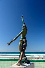 Reaching for the Sky (Jocey K) Tags: ocean sky people beach water bronze sand surf waves australia flags queensland surfersparadise goldcoast sculputre triptoqueenslandbrisbane
