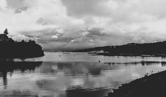 Loch Lomond, Scotland (christaadams) Tags: travel sky blackandwhite lake reflection water clouds dark glasgow loch bnw lochlomond