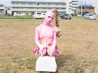 Pink and White Rubber Latex Clothing with Randoseru in Public
