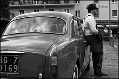 (artigiano) Tags: street people italy blackwhite malcesine sonyas lancia scharzweiss silverefex loxia250 zeissloxia