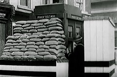 Very Rare Image: WW2. London Metropolitan Police (Tardis Style) Telephone Box Protected From Expected Bomb Damage. Police Constable In Wartime Uniform Using The Telephone System To Contact His Station. Circa 1939-45. (sgterniebilko) Tags: uk london 1940 doctorwho ww2 historical 1942 tardis 1945 rare 1941 telephonebox 1939 1944 1943 sandbags timemachine londonpolice worldwartwo scotlandyard metropolitanpolice 19391945 policeconstable policelondon rareimage historicalimage wartimelondon policehistorical ukwartime bombprotection policepublictelephonebox