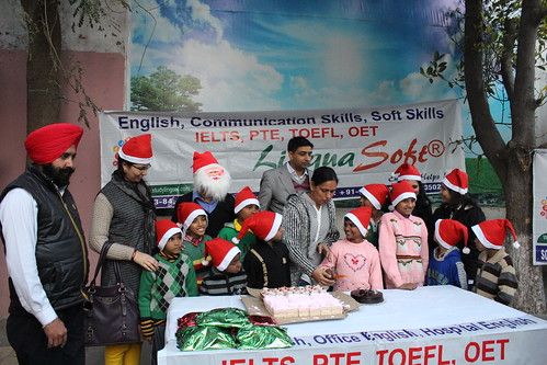 Cake Cutting ceremony by Director LinguaSoft EduTech Ms. Parwinder Kaur Ashiana children's home