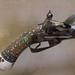 Antique pistol with inlaid decoration