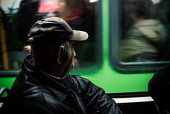 Brim and Stache (ewitsoe) Tags: tram autumn man lookingoutthewindow wet rain fall nikond80 35mm ewitsoe street portrait profile transit pedestrian poland poznan polska