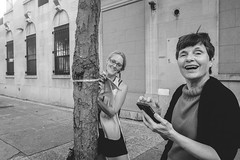 Tree Huggers, Jamaica Queens (L A Nolan) Tags: 185mmf28 28mmequiv day fujifilmx70 jamaicaqueens newyork newyorkcity newyorknewyork ny nyc outdoors outside people queens smile streetphotography streetportrait thebigapple women treecount tree
