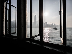Hong Kong 02 (arsamie) Tags: hong kong china asia window view harbour pier ferry city skyline wide angle boat sea island sun clair obscur contrejour buildings skyscrapers