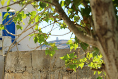windmill on the backround (Katrinitsa) Tags: street blue summer white house tree window windmill colors canon island mediterranean village bokeh hill aegean streetphotography greece greekislands narrow paros cyclades lefkes villagelife backround kyklades villagescape sokaki