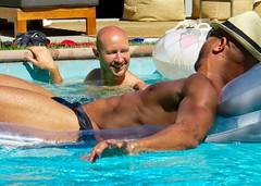 IMG_0177 (danimaniacs) Tags: shirtless man hot sexy guy smile hat beard fun hunk swimmingpool cap raft speedo float swimsuit stud scruff