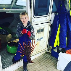 Gabriel Gregory-hunt 3rd generation fisherman decked out in storm line gear crayfishing with Dad Andrew in the Chatham Islands