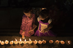 Kids lighting Dia's (Ravikanth K) Tags: travel light people india girl festival kids fire outdoor dia celebration dev varanasi lamps diwali ganga deepawali ganges benaras karthika earthen pournami kasi 500px karthiga
