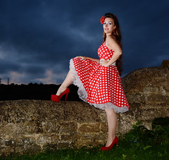 Holly hw 047 (Fast an' Bulbous) Tags: girl woman polkadot dress stone wall dusk twilight outdoor people long brunette hair high heels stilettos red shoes female beauty hot sexy northamptonshire nikon d7100 gimp offcamera flash strobist petticoat stockings silk seamed