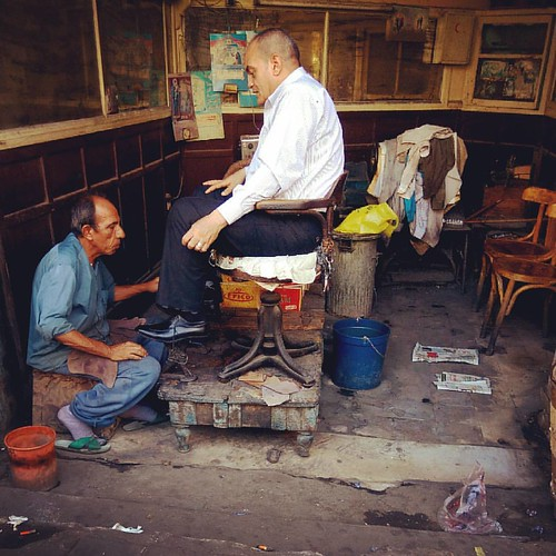 #shoeshiner cleans #shoes for a man #2016 #bootpolisher #street #clean #poor #huawei #thisisegypt #everydaymiddleeast #everydayegypt #everydayeverywhere #streetphotographers #mobilephoto #instadaily #instagram #everydayafrica #reportagespotlight #instagoo