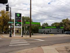Gas + Grass--Nobody rides for free (mount_evans) Tags: olympus omd em5 microfourthirds mzuiko1250mmf3563 existinglight outdoor coloradosprings colorado sign marijuanadispensary