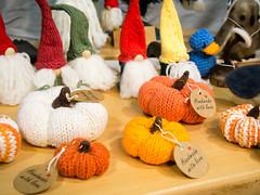 Nisse and knitted pumpkins by Lori Shininger, North by Northwest Designs (marketkim) Tags: holidaymarket product eugene oregon saturdaymarket festival artfair eugenesaturdaymarket artfestival