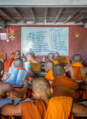 Buddhist Monks at School (sachasplasher) Tags: school learn learning whiteboard orange monk monks children child writing write read copy blackboard buddhism buddhist cambodia asia