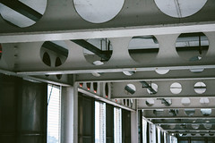 Metal (JacksonSwaby) Tags: metal circle pattern ceiling roof structure construction city park parking carpark building pipe pillar geometry
