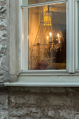 Window in old town (AudioClassic) Tags: window oldtown chandelier candle light house stone tallinn medieval city reflections lantern lamp winter christmas holydays