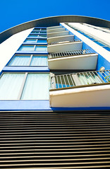 Looking up (AmeliaIsobel) Tags: blue windows sky building lines architecture bristol intense curves cream clear bold