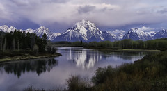 Early Oxbow Morning (Jeff Clow) Tags: morning travel usa lake mountains reflection tourism nature water river landscape dawn spring twilight quiet may peaceful western wyoming majestic iconic grandtetonnationalpark 2015 jacksonholewyoming jeffrclow