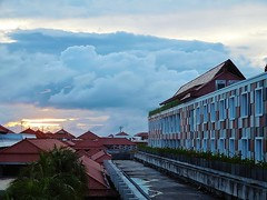 Bali airport sunset 2 (SM Tham) Tags: asia indonesia bali ngurahraiinternationalairport airport sunset dusk sky clouds buildings rooftops trees