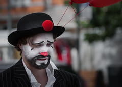 Sad clown (Gunnar Sreng) Tags: wwpw2016 clown sadness streetphotography portrait facepainting costume sad mood beard bowlerhat hat