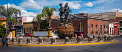 2016 - Mexico - San Luis Potosi - Plaza del Mienio (Ted's photos - Returns late December) Tags: 2016 cropped mexico nikon nikond750 nikonfx sanluispotosi tedmcgrath tedsphotos tedsphotosmexico vignetting fountain waterfountain bollards bicycle streetscene people peopleandpaths sanluispotosiphotos curb chain chainlinks plazadelmienio plazadelmieniosanluispotosi