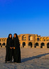 Portrait of two young women in chadors in front of khaju bridge pol-e khaju, Isfahan province, Isfahan, Iran (Eric Lafforgue) Tags: 20s 2people ancient arches architectural architecture attraction blue bricks bridge chador clearsky colorimage copyspace day dried esfahan fullframe fulllength hispahan iran iranian isfahan ispahan khajubridge middleeast muslim orient outdoors persia photography river spadana sunny tourism touristic traveldestinations twopeople unescoworldheritagesite urban veiled vertical women womenonly youngadults zayandeh isfahanprovince