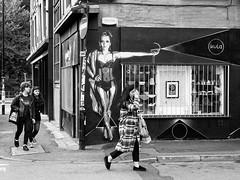 Northern Quarter #141 (Peter.Bartlett) Tags: manchester bag niksilverefex walking shopfront art unitedkingdom woman people window corner olympuspenf urbanarte urban boy shopwindow streetphotography lunaphoto shutter girl facade monochrome uk m43 microfourthirds peterbartlett bw noiretblanc sign blackandwhite couple city