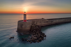 Light Beacon (Sam_C_Moore) Tags: mavicpro djiglobal newhaven seascape drone aerial photography magicalsunset water ocean lighthouse glow beacon uav